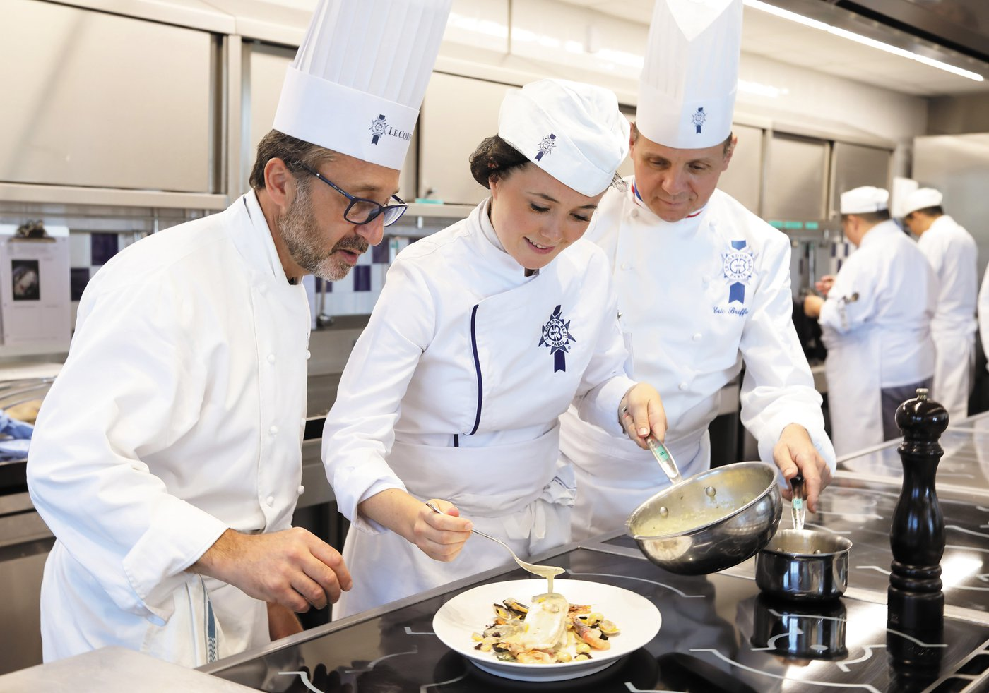 Le-Cordon-Bleu-Paris-Practical-Cuisine-Chef-Caussimon-Chef-Briffard-and-Student.jpg