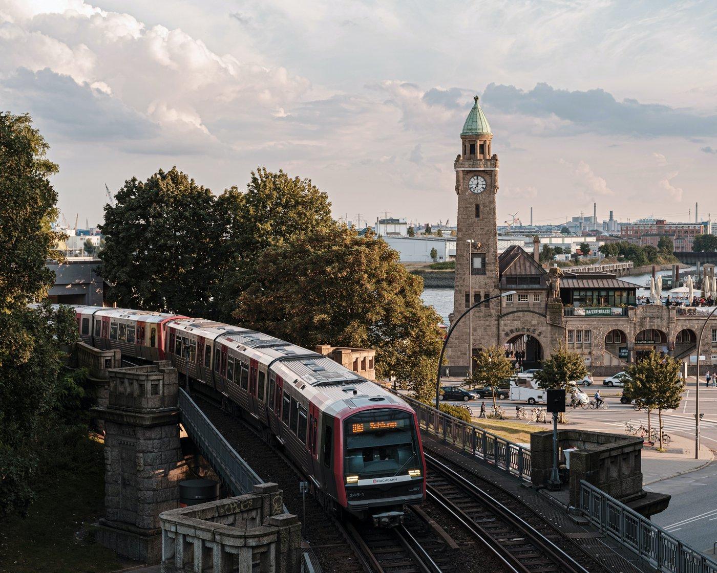 Landungsbruecke clock tower and the hochbahn train in Hamburg